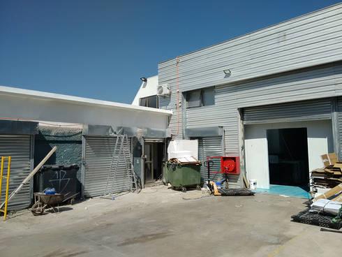 Vista exterior: Oficinas y Comercios de estilo  por DIMA Arquitectura y Construcción