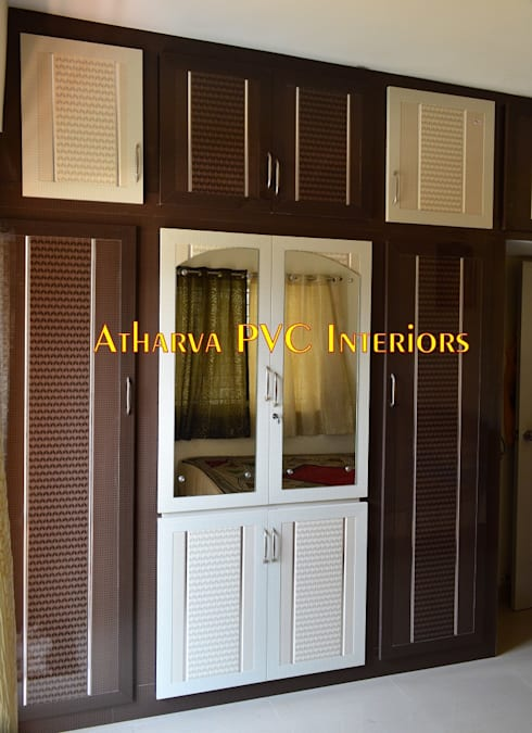 PVC Wardrobes: modern Bedroom by Atharva PVC Interiors