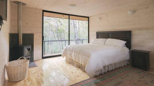 Dormitorios de estilo rústico por Ciclo Arquitectura