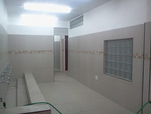 MSJ:  Walls & flooring by MSJ INVESTMENTS CONSTRUCTION.
