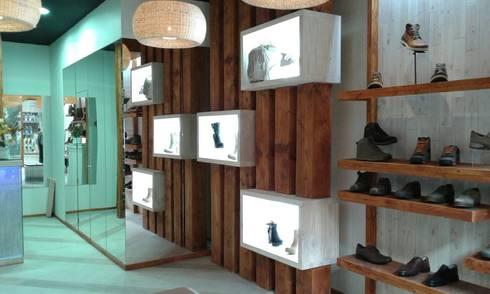 Mostrador rustico: Oficinas y tiendas de estilo  por Mozo Garcia Arquitectos Ltda