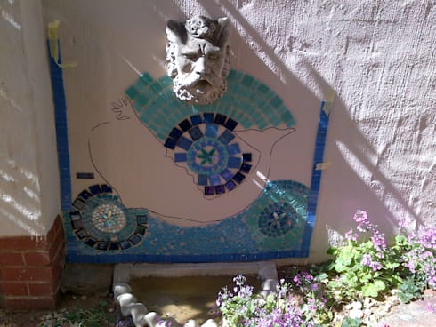 Mosaic in progress on a wall:   by SOJE Interior, Design and Decor PTY (Ltd)