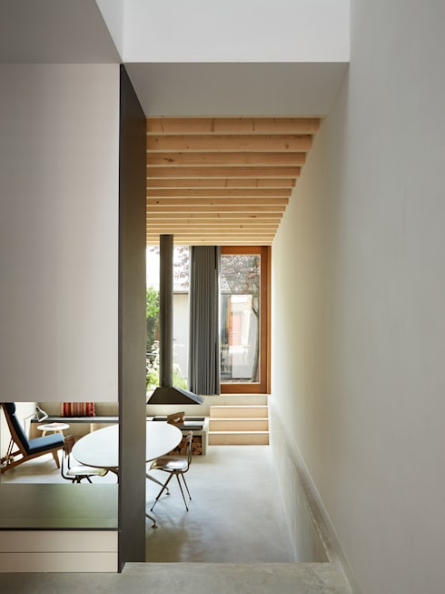 Wenslauer House:  Living room by 31/44 Architects