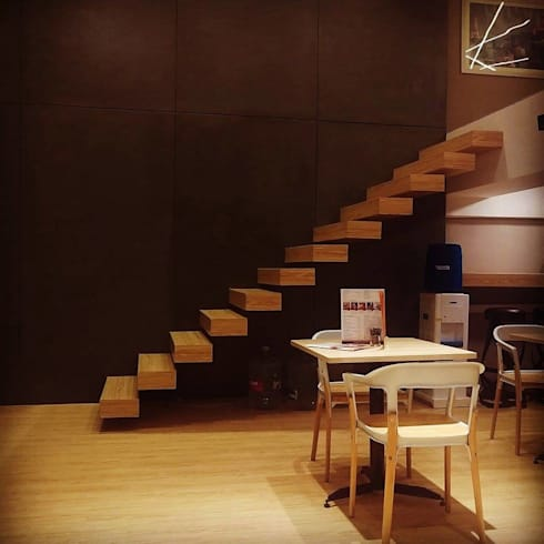 Creperie:  Corridor, hallway & stairs  by Inspire Interiors & Archcons India Pvt Ltd