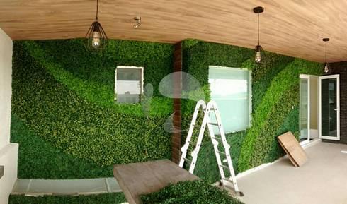 Muros verdes y pasto sint ticos de muros verdes y pasto for Jardines de pared para interiores