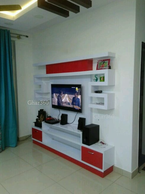 Completed Projects Mix: modern Living room by Ghar360