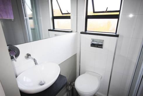 Square Elephant bathroom: modern Bathroom by Berman-Kalil Housing Concepts