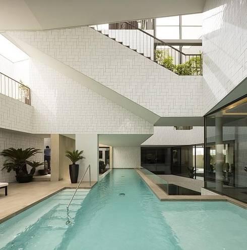 Jardines de estilo  por AGi architects