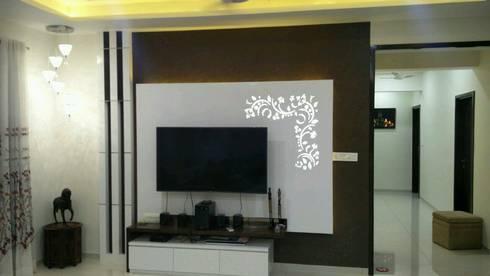 LCD unit in drawing room:   by Ar. Ananya Agarwal