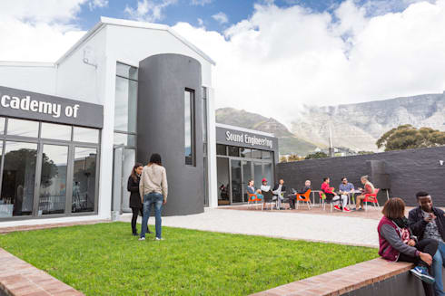 entrance courtyard:  Schools by Till Manecke:Architect