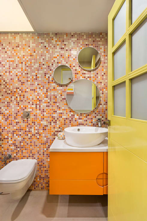 Colourful Wall-Tiled Washroom: modern Bathroom by The design house