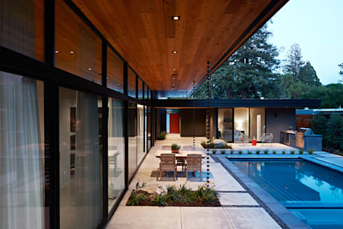 Glass Wall House: modern Houses by Klopf Architecture