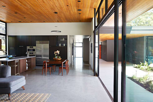 Glass Wall House: modern Dining room by Klopf Architecture