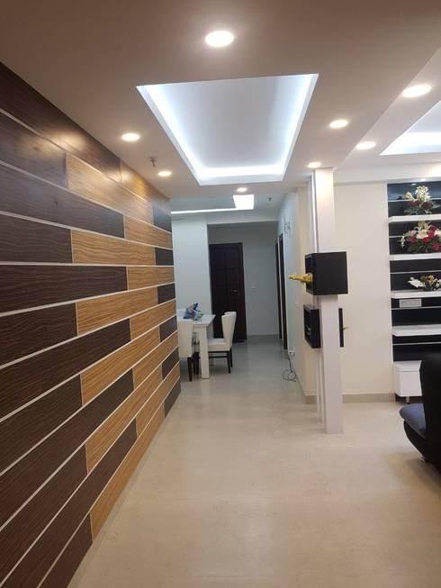 Jain's residency:  Corridor, hallway & stairs  by Fabros Interiors