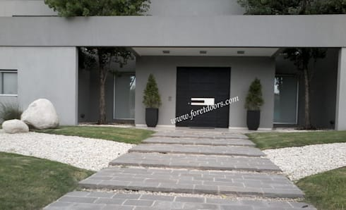 Modern front entry door with c-shaped modern stainless steel pull:  Windows & doors  by Foret Doors