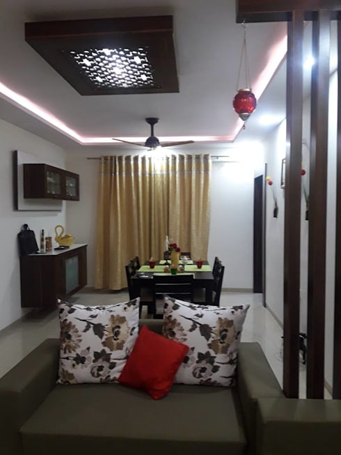 Living room (2BHK, Sigma Towers, Kondapur):  Living room by Kreative design studio