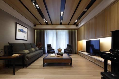 實木皮的美式線條:  客廳 by 誼軒室內裝修設計有限公司