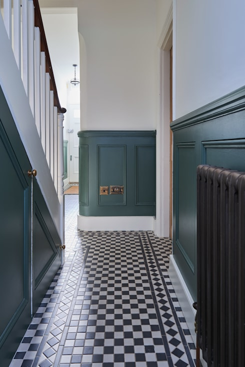 Dark green wood panelling in the hallway: country Corridor, hallway & stairs by Purdom's Bespoke Furniture