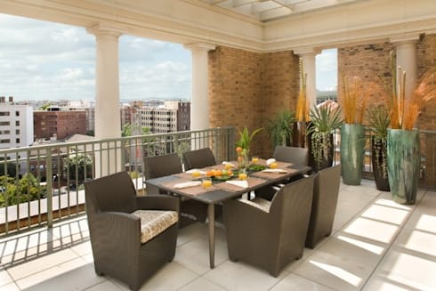 Penthouse Posh - Terrace Dining:  Patios & Decks by Lorna Gross Interior Design