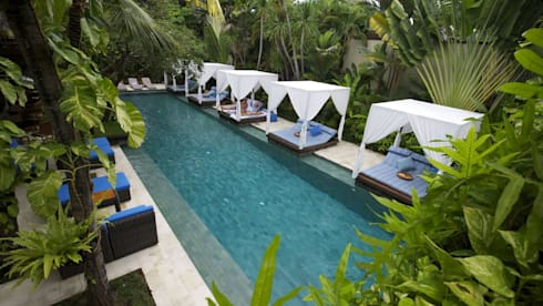 The Elysian Villas resort limestone pool:  Hotels by The Elysian