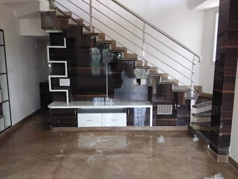 A 3 bhk flat by exinfra projects homify for Tv showcase designs under staircase