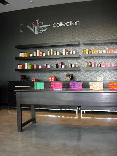 Luxury Retail Shop:  Offices & stores by Sight Projects + Interiors (PTY) LTD