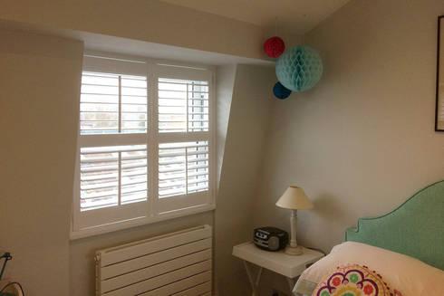Bedroom shutters for sash windows: classic Bedroom by Plantation Shutters Ltd