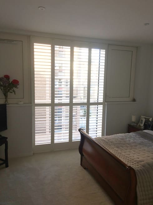 Bi-fold shutters for bedroom doors: classic Bedroom by Plantation Shutters Ltd