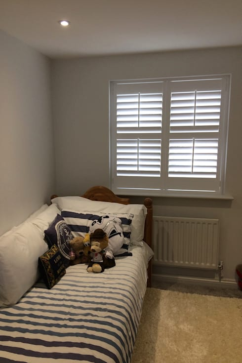 Full height shutters for kids bedroom windows: modern Bedroom by Plantation Shutters Ltd