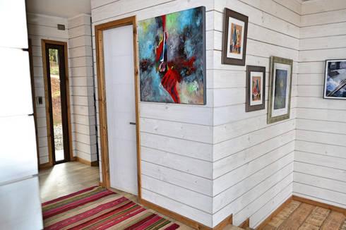 Casa Vichuquén: Paredes de estilo  por AtelierStudio