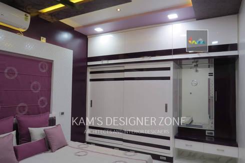 Home interior design for Mr. Aji John:  Walls by KAM'S DESIGNER ZONE