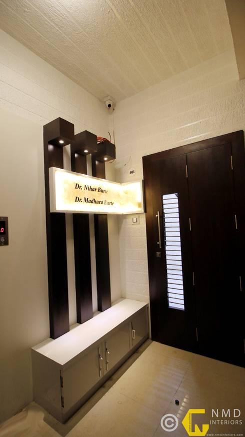 Dr Burte:  Corridor, hallway & stairs  by NMD Interiors