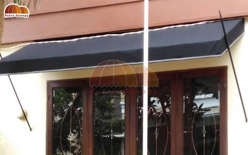 Canopy Kain Tombak:  Balconies, verandas & terraces  by Putra Canopy