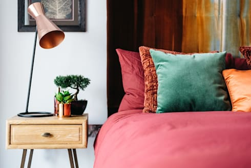 Master Bedroom with bespoke headboard and cushions.: modern Bedroom by Katie Malik Interiors