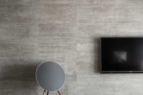 電視牆面:  客廳 by 一水一木設計工作室