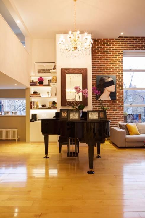Living room by JKG Interiors