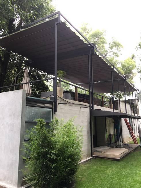 Casa los Dínamos: Casas de estilo  por Materia Viva S.A. de C.V.