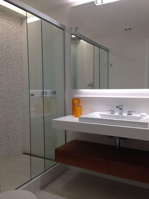 Banheiro suite: Banheiros  por daniela kuhn arquitetura