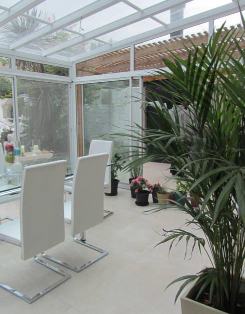 Jardines de invierno de estilo  por Arquitecta MORIELLO