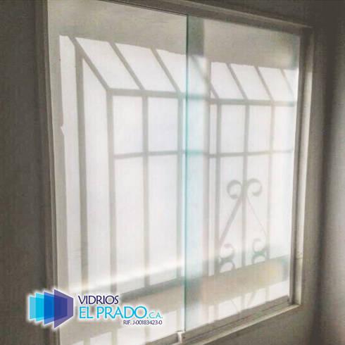 ventanas corredizas : Ventanas de estilo  por vidrios el prado