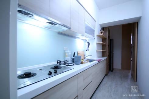 高雄新興 謝公館:  廚房 by 協億室內設計有限公司