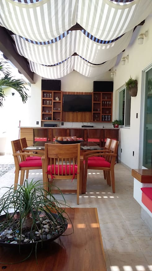 TERRAZA / BAR CASA LAS FLORES: Terrazas de estilo  por EL DIVÁN Arquitectura & Diseño de Interiores
