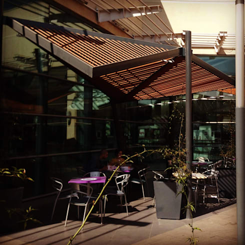 MALL PLAZA ALAMEDA: Balcones y terrazas de estilo  por surarquitectura