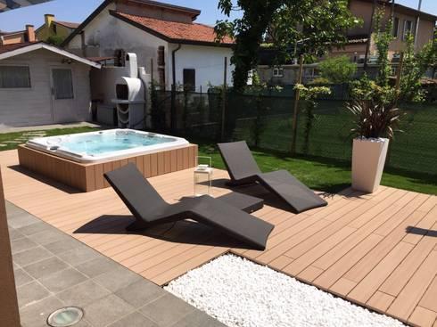 Arredare un giardino con una jacuzzi di aquazzura piscine for Arredare il giardino