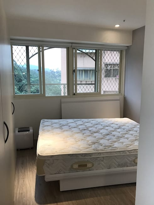 空間魔法 將門片設計成像櫃體一樣 達到整體設計感:  臥室 by 捷士空間設計