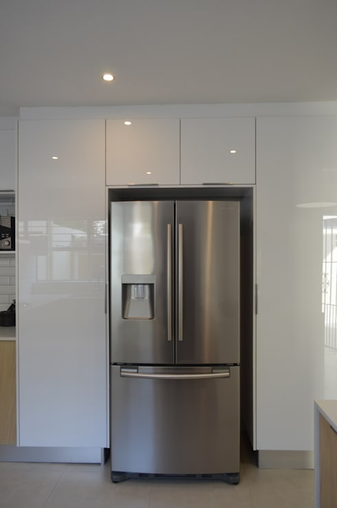 acrylic white: modern Kitchen by Première Interior Designs