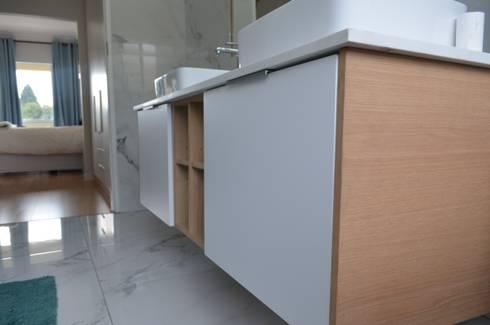 bathroom floating unit: modern Bathroom by Première Interior Designs