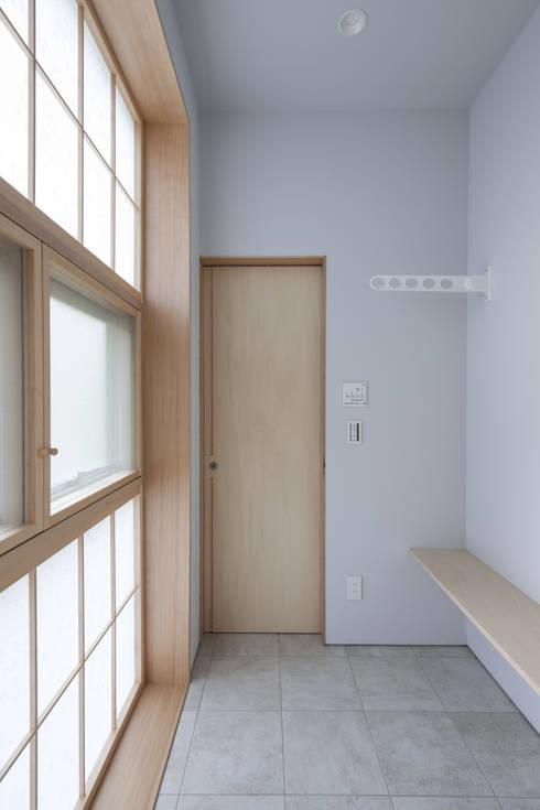 六本木の庫裡 洗濯室: abanba inc.が手掛けたサンルームです。