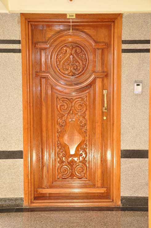Interior Door Design:  Living room by Scale Inch Pvt. Ltd.