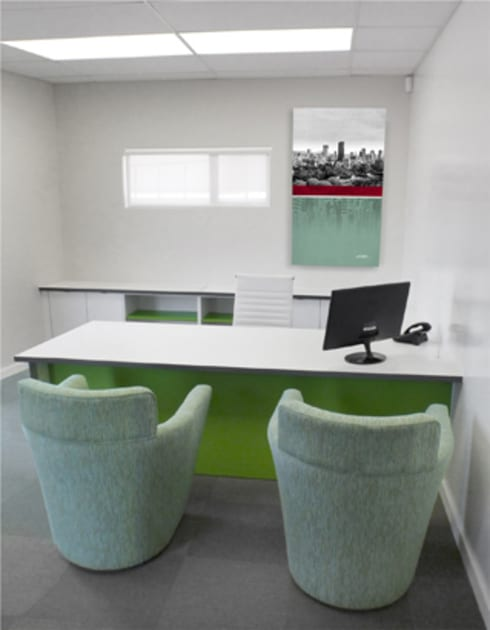SIMS Travel:  Office spaces & stores  by Full Circle Design